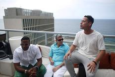 (L-R) Members of the Cuban fusion group Orishas, Yotuel, Roldan and Ruzzo, give an interview from the top of a building in Havana, Cuba, June 22, 2016. REUTERS/Alexandre Meneghini