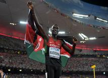 Aug 25, 2015; Beijing, China; David Rudisha (KEN) takes a victory lap with Kenyan flag after winning the 800m in 1:45.84 during the IAAF World Championships in Athletics at National Stadium. Mandatory Credit: Kirby Lee-USA TODAY Sports