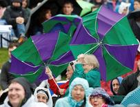 Britain Tennis - Wimbledon - All England Lawn Tennis & Croquet Club, Wimbledon, England - 29/6/16 Spectators with umbrellas as rain delays play REUTERS/Paul Childs