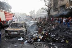Район аль-Каррада после взрыва заминированного автомобиля. Багдад, 3 июля 2016 года. Количество погибших в результате двух взрывов в Багдаде возросло до 147 человек, еще 35 числятся пропавшими без вести, сообщили источники в полиции и врачи в понедельник. REUTERS/Khalid al Mousily