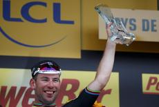 Cycling - Tour de France cycling race - The 223,5-km (139 miles) Stage 3 from Granville to Angers, France - 04/07/2016 - Team Dimension Data rider Mark Cavendish of Britain reacts on podium after winning the stage.      REUTERS/Juan Medina