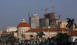 Office buildings under construction stand behind the Angolan central bank building in the capital, Luanda, in this file photo. REUTERS/Mike Hutchings/Files