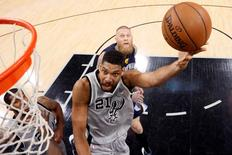 Apr 17, 2016; San Antonio, TX, USA; San Antonio Spurs power forward Tim Duncan (21) shoots the ball past Memphis Grizzlies power forward Chris Andersen (7, behind) during the second half in game one of the first round of the NBA Playoffs at AT&T Center. Mandatory Credit: Soobum Im-USA TODAY Sports