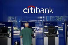 A man uses a Citibank ATM at a branch in Caracas, Venezuela July 12, 2016. REUTERS/Carlos Garcia Rawlins