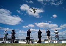 The Airbus Industrie A380 aircraft performs a manoeuvre during its display at the 2014 Farnborough International Airshow in Farnborough, southern England July 14, 2014.    REUTERS/Kieran Doherty/File Photo