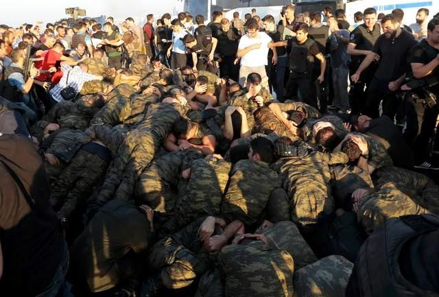 Surrendered Turkish soldiers who were involved in the coup are surrounded by people on Bosphorus bridge in Istanbul, Turkey, July 16, 2016.     REUTERS/Stringer