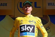 Yellow jersey leader Team Sky rider Chris Froome of Britain reacts on the podium. REUTERS/Juan Medina