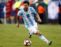 Argentina midfielder Lionel Messi (10) carries the ball during the second half of Argentina's 4-1 win over Venezuela in quarter-final play in the 2016 Copa America Centenario soccer tournament at Gillette Stadium. Mandatory Credit: Winslow Townson-USA TODAY Sports