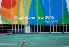 A man walks inside the 2016 Rio Olympics Park in Rio de Janeiro, Brazil, July 16, 2016.   REUTERS/Stoyan Nenov