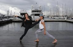 "Romanian former gymnast star Nadia Comaneci (L) poses during a photocall for the television reality show ""Tumble"" during the annual MIPCOM television programme market in Cannes, October 14, 2014.  REUTERS/Eric Gaillard"