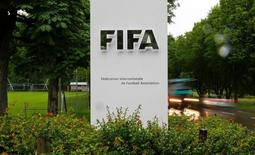 Cars drive past a logo in front of FIFA's headquarters in Zurich, Switzerland June 8, 2016. REUTERS/Arnd Wiegmann