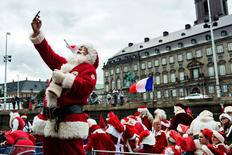 A participant takes a selfie at the 59th World Santa Convention, which was attended by participants from different countries, in Copenhagen July 18, 2016. Scanpix Denmark/Mathias Loevgreen Bojesen/via REUTERS