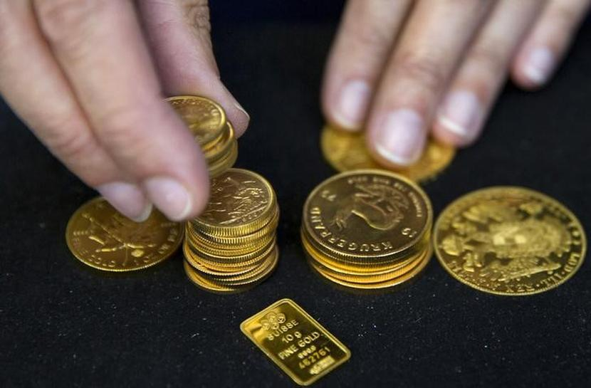 Gold holds on to overnight gains as stocks, dollar retreat | Reuters