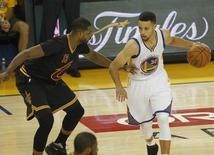 June 19, 2016; Oakland, CA, USA; Golden State Warriors guard Stephen Curry (30) moves the ball against Cleveland Cavaliers center Tristan Thompson (13) in the first half in game seven of the NBA Finals at Oracle Arena. Mandatory Credit: Cary Edmondson-USA TODAY Sports