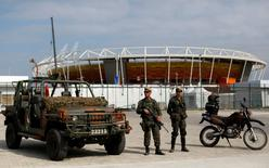 Brazilian Army soldiers patrol in front of the Olympic park ahead of the 2016 Rio Olympics in Rio de Janeiro, Brazil, July 19, 2016.  REUTERS/Bruno Kelly