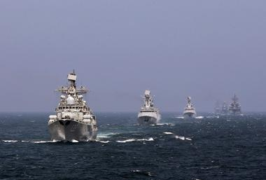 Chinese and Russian naval vessels participate in the Joint Sea-2014 naval...
