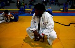2016 Rio Olympics - Judo - Refugee Olympic Team Training - Reacao Institute - Rio De Janeiro, Brazil - 28/07/2016. Refugee and judo athlete from the Democratic Republic of Congo Popole Misenga trains during a training session. REUTERS/Nacho Doce