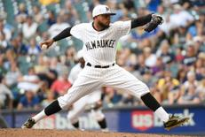 Jun 25, 2016; Milwaukee, WI, USA; Milwaukee Brewers pitcher Jeremy Jeffress (21) pitches in the ninth inning against the Washington Nationals at Miller Park. Jeffress picked up a save as the Brewers beat the Nationals 6-5. Mandatory Credit: Benny Sieu-USA TODAY Sports