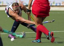 Katelyn Falgowski of the United States takes a shot against the Dominican Republic during women's field hockey action at the 2015 Pan Am Games in Toronto, Ontario July 20, 2015.  REUTERS/Steve McKinley