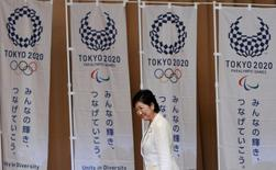 Tokyo's first woman Governor Yuriko Koike walks past Tokyo 2020 Olympic and Paralympic Games flags as she goes onstage to make a speech at Tokyo Metropolitan Government Building in Tokyo, Japan, August 2, 2016.    REUTERS/Kim Kyung-Hoon