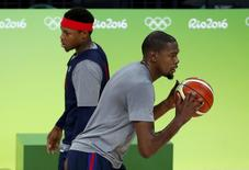 Kevin Durant (USA) of USA and Kyle Lowry (USA) of USA train. REUTERS/Jim Young