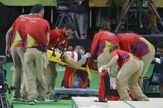 2016 Rio Olympics - Artistic Gymnastics - Preliminary - Men's Qualification - Subdivisions - Rio Olympic Arena - Rio de Janeiro, Brazil - 06/08/2016. Samir Ait Said (FRA) of France is placed on a stretcher after breaking his leg during competition on the vault. REUTERS/Damir Sagolj