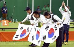 2016 Rio Olympics - Archery - Final - Men's Team Gold Medal Match - Sambodromo - Rio de Janeiro, Brazil - 06/08/2016. (L-R) South Korea's Lee Seung-Yun (KOR), Kim Woo-Jin (KOR) and Ku Bon-Chan (KOR) celebrate after winning the gold.  REUTERS/Yves Herman