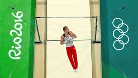 2016 Rio Olympics - Artistic Gymnastics - Preliminary - Men's Qualification - Subdivisions - Rio Olympic Arena - Rio de Janeiro, Brazil - 06/08/2016  Fabian Hambuechen (GER) of Germany competes during the men's qualifications on the horizontal bar. REUTERS/Athit Perawongmetha