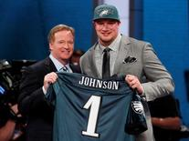 Lane Johnson (R) from the University of Oklahoma stands with NFL Commissioner Roger Goodell after being selected by the Philadelphia Eagles as the fourth overall pick in the 2013 National Football League (NFL) Draft at Radio City Music Hall in New York, April 25, 2013. REUTERS/Adam Hunger