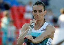 Yelena Isinbayeva warms up before an attempt at the Russian Track and Field Championships in Cheboksary, Russia, June 21, 2016. REUTERS/Sergei Karpukhin