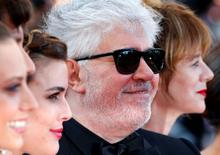 "Director Pedro Almodovar (C), cast members Adriana Ugarte (L) and Emma Suarez pose on the red carpet as they arrive for the screening of the film ""Julieta"" in competition at the 69th Cannes Film Festival in Cannes, France, May 17, 2016.      REUTERS/Yves Herman"