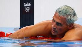 Ryan Lochte (USA) of USA reacts. REUTERS/David Gray