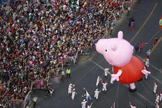 The Peppa Pig balloon makes its way along the streets during an annual Christmas parade at Santiago town in Chile, December 13, 2015. REUTERS/Pablo Sanhueza