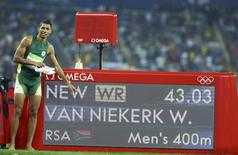 2016 Rio Olympics - Athletics - Final - Men's 400m Final - Olympic Stadium - Rio de Janeiro, Brazil - 14/08/2016. Gold medalist Wayde van Niekerk (RSA) of South Africa points to the board showing his new world new record. REUTERS/Lucy Nicholson
