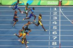 2016 Rio Olympics - Athletics - Final - Men's 100m Final - Olympic Stadium - Rio de Janeiro, Brazil - 14/08/2016.  Usain Bolt (JAM) of Jamaica wins the gold medal in the men's 100m final.   REUTERS/Carlos Barria