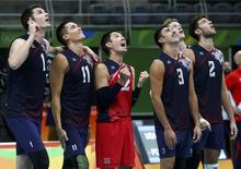 2016 Rio Olympics - Volleyball Men's Quarterfinals - USA v Poland - Maracanazinho - Rio de Janeiro, Brazil - 17/08/2016. Matt Anderson (USA) of USA, Micah Christenson (USA) of USA, Erik Shoji (USA) of USA, Taylor Sander (USA) of USA, and Aaron Russell (USA) of USA react.  REUTERS/Yves Herman  TPX IMAGES OF THE DAY.