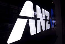 A man walks past a branch of the Australia and New Zealand Banking Group Ltd (ANZ) in Sydney October 29, 2013.  REUTERS/David Gray/File Photo