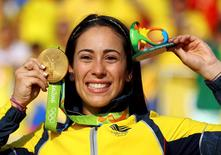 2016 Rio Olympics - Cycling BMX - Victory Ceremony - Women's BMX Victory Ceremony - Olympic BMX Centre - Rio de Janeiro, Brazil - 19/08/2016. Mariana Pajon (COL) of Colombia poses with the gold medal.  REUTERS/Paul Hanna