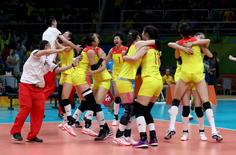 2016 Rio Olympics - Volleyball - Women's Gold Medal Match China v Serbia - Maracanazinho - Rio de Janeiro, Brazil - 21/08/2016. China's (CHN) players celebrate winning the match and the gold medal.  REUTERS/Yves Herman