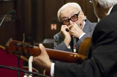 Belgian musician Toots Thielemans plays harmonicza during a ceremony for his 90th birthday at Brussels' City Hall April 29, 2012. REUTERS/Sebastien Pirlet/Files
