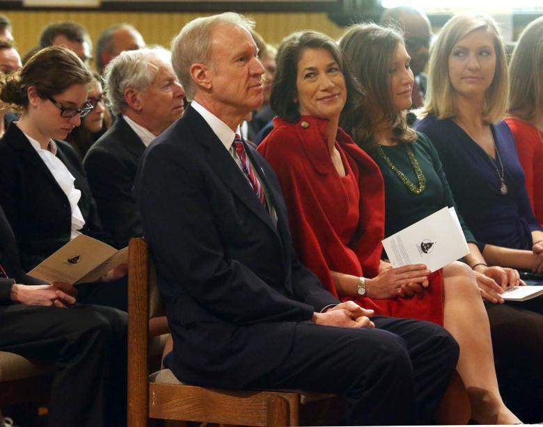 Bruce Rauner and his wife Diana attend an interfaith prayer service at First Presbyterian Church in Springfield at an interfaith prayer service at First Presbyterian Church in Springfield, Illinois, January 12, 2015.  REUTERS/Nancy Stone/Chicago Tribune/Pool