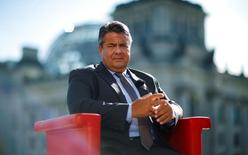 German Economy Minister Sigmar Gabriel arrives for a television interview in front of the Reichstag building in Berlin, Germany, August 7, 2016. REUTERS/Hannibal Hanschke