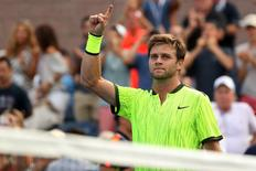 Aug 31, 2016; New York, NY, USA; Ryan Harrison of the United States celebrates after his match against Milos Raonic of Canada (not pictured) on day three of the 2016 U.S. Open tennis tournament at USTA Billie Jean King National Tennis Center. Harrison won 6-7(4), 7-5, 7-5, 6-1. Mandatory Credit: Geoff Burke-USA TODAY Sports