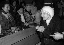 Mother Teresa is welcomed by lepers as she arrives at St. Lazarus Leprosy Village's church in Shinhung, Korea on January 27, 1985. REUTERS/Tony Chung
