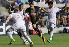 Aug 27, 2016; Philadelphia, PA, USA; Philadelphia Union midfielder Tranquillo Barnetta (10) controls the ball against Sporting KC defender Matt Besler (5) and midfielder Sony Mustivar (93) during the second half at Talen Energy Stadium. The Union won 2-0. Mandatory Credit: Bill Streicher-USA TODAY Sports
