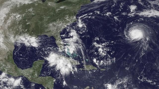 Three storm systems are shown (L TO R) Tropical Depression Nine to the southeast of Florida, Tropical Depression Eight just off the coast of the Carolinas and Hurricane Gaston in the central Atlantic Ocean are shown in this GOES East satellite image captured August 29, 2016.  NOAA/handout via REUTERS
