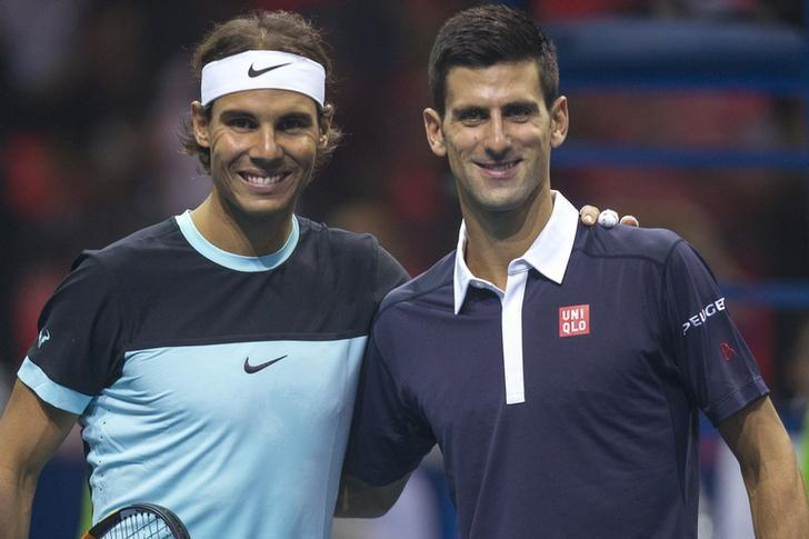 Rafael Nadal of Spain (L)  and Novak Djokovic of Serbia pose for photograph before their ''Back To Thailand - Nadal vs Djokovic'' friendly tennis match in Bangkok, Thailand, October 2, 2015. REUTERS/Athit Perawongmetha/Files