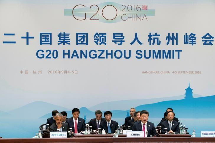 Chinese President Xi Jinping, front right, speaks during the opening ceremony of the G20 Summit in Hangzhou in eastern China's Zhejiang province, Sunday, Sept. 4, 2016. REUTERS/Mark Schiefelbein/Pool