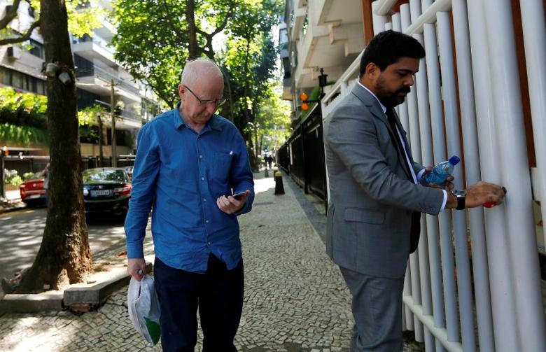 Former top European member of the International Olympic Committee (IOC), Patrick Hickey (L), arrives at a residential building after leaving the Bangu Jails Complex in Rio de Janeiro, Brazil, August 30, 2016. REUTERS/Ricardo Moraes