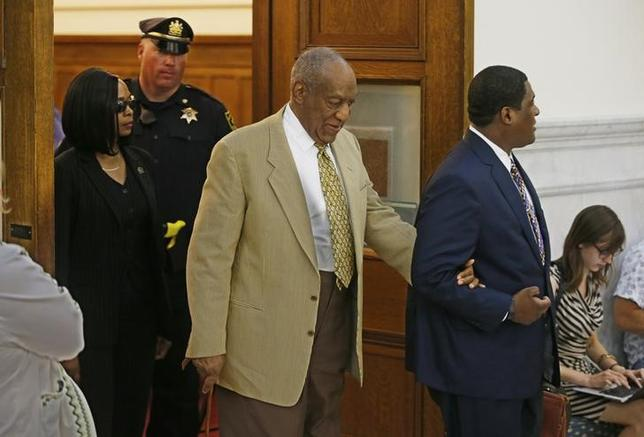 Bill Cosby (C) is led out of Courtroom A of the Montgomery County Courthouse in Philadelphia, Pennsylvania, U.S. July 7, 2016.  REUTERS/Michael Bryant/Pool/Files